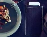 Компания IKEA представила скатерти с карманами для мобильных телефонов.